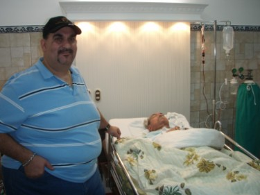 Luis Rodriguez, stem cell coordinator and support person, next to his father, who got treated for COPD and CHF