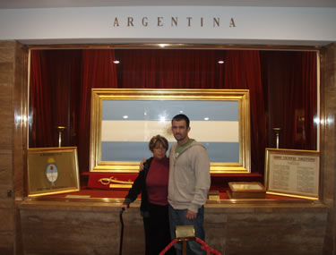 Inside the Argentinian National Flag Memorial, standing in front of the Argentinian flag with my mom